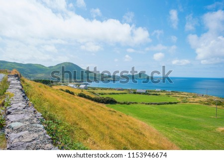 Rocky hilly coast of Kerry along the atlantic ocean in summer #1153946674