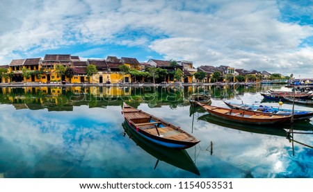 view of busy river in Hoi An, Vietnam. Hoi An is the World's Cultural heritage site, famous for mixed cultures and architecture.                               #1154053531