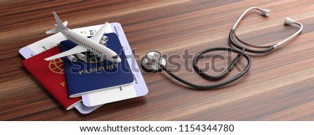 Air travelling for health concept. Blue and red passports and medical stethoscope isolated on wooden background, banner. 3d illustration