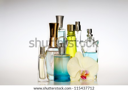 Multicolored perfumes in bottles of different shapes #115437712