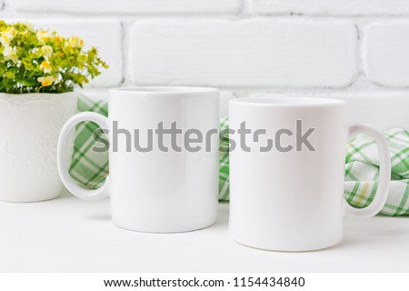 Two white coffee  mug mockup with small yellow and green flowers.  Empty mug mock up for design promotion.    #1154434840