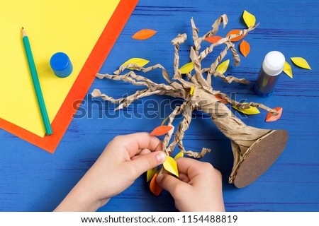 How to make together with child autumn tree from craft package. Original children's art project. DIY concept. Step-by-step photo instructions. Step 9. Glue leaves of tree #1154488819