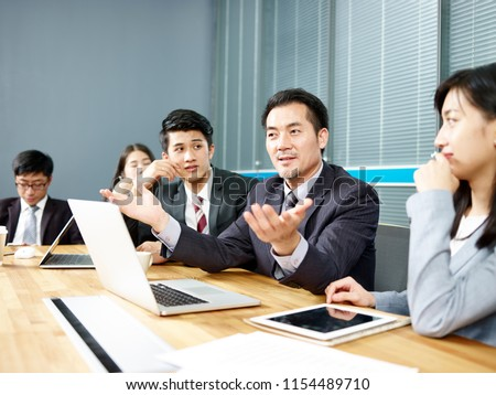 asian corporate executive and his business team meeting and negotiating with client. Royalty-Free Stock Photo #1154489710