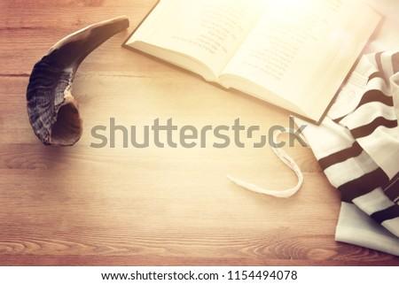 Prayer Shawl - Tallit, Prayer book and Shofar (horn) jewish religious symbols. Rosh hashanah (jewish New Year holiday), Shabbat and Yom kippur concept. #1154494078