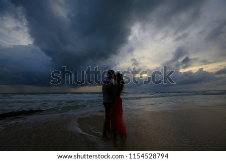 Couple Kissing On The Beach With A Beautiful Sunset #1154528794