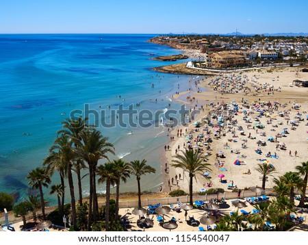 Popular great summer vacation travel destination La Zenia Beach Orihuela Costa South Spain #1154540047