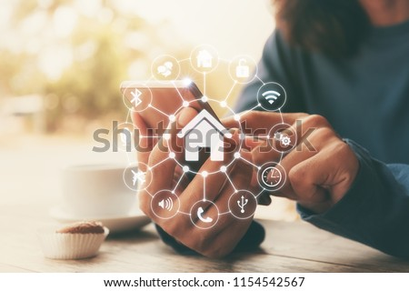 Smart home control with Smartphone,Lifestyle of person in modern life internet of things, Smart house technology.The new innovation of the Future. #1154542567