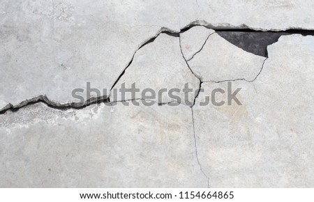 Cement crack wall texture background.  Royalty-Free Stock Photo #1154664865