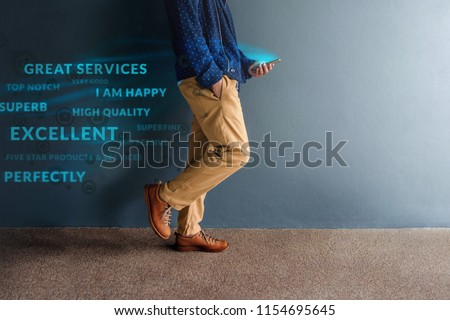 Customer Experience Concept. Person Walking and Reading Positive Online Review via Smartphone Royalty-Free Stock Photo #1154695645