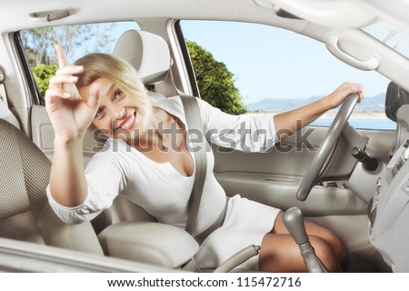portrait of young beautiful woman sitting in the car #115472716