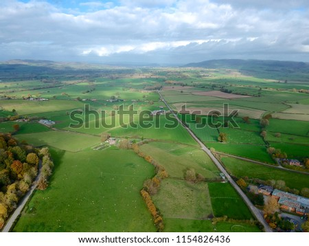 Aerial view of beautiful valley in mid Wales. Green landscape with small valley. Aerial drone view of rural Wales #1154826436