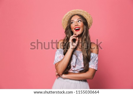 Portrait of pretty glamour woman 20s wearing straw hat laughing and looking aside isolated over pink background in studio #1155030664