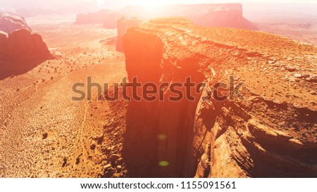 Bird's eye scenery view of beautiful Monument Valley famous landmark of southwest USA. Aerial view of brown cliffs in sandy dessert of Arizona #1155091561