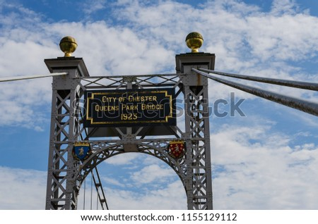 Chester, UK: Aug 6, 2018: A detail view of the Queens Park Suspension Bridge which spans the River Dee and connects Chester city centre with Queens Park. The bridge is for pedestrians only. #1155129112