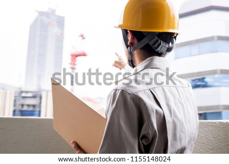 Worker looking at the construction #1155148024
