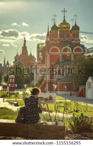 Moscow, Russia - August 09, 2018: The young artist draws a city landscape in the Zaryadye park #1155156295