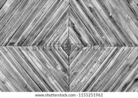 A diamond-shaped pattern of the old wooden boards,black and wite background #1155251962