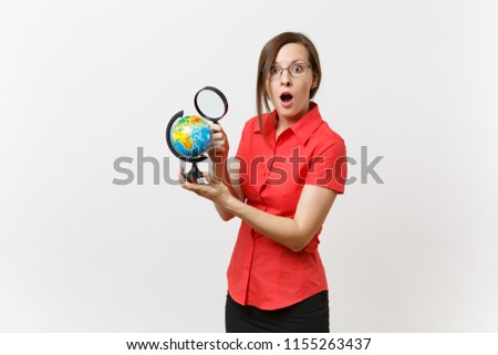 Portrait of business teacher woman in red shirt holding and looking through magnifying glass on globe isolated on white background. Education teaching in high school university concept. Copy space #1155263437