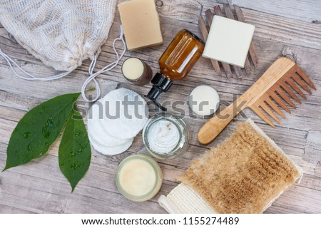 Zero waste bathroom accessories, natural sisal brush, wooden comb, deodorant, shea butter, solid soap and shampoo bars, reusable cotton make up removal pads, make up remover in a glass container.  #1155274489
