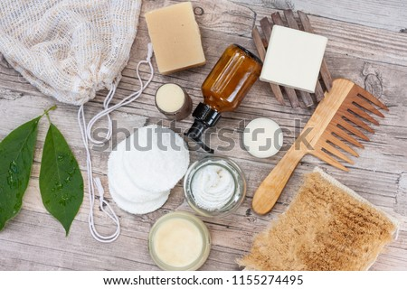 Zero waste bathroom accessories, natural sisal brush, wooden comb, deodorant, shea butter, solid soap and shampoo bars, reusable cotton make up removal pads, make up remover in a glass container.  Royalty-Free Stock Photo #1155274495