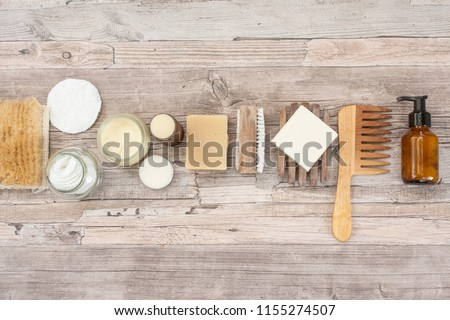 Zero waste bathroom accessories, natural sisal brush, wooden comb, deodorant, shea butter, solid soap and shampoo bars, reusable cotton make up removal pads, make up remover in a glass container.  #1155274507