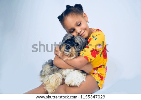 Girl hugging her pet dog #1155347029