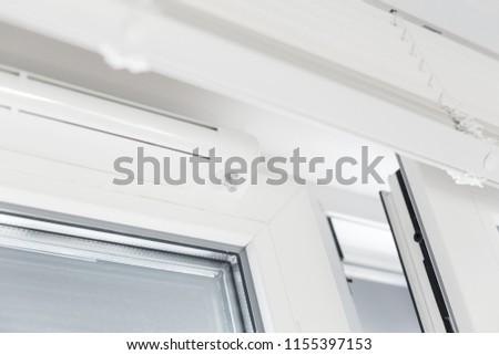 Double glazed window with ventilation unit. Closeup. Nobody #1155397153