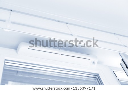 Double glazed window with ventilation unit. Closeup. Nobody. Blue tone #1155397171