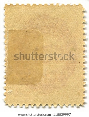 The reverse side of a postage stamp. #115539997