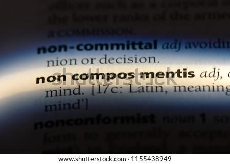 non compos mentis word in a dictionary. non compos mentis concept. #1155438949