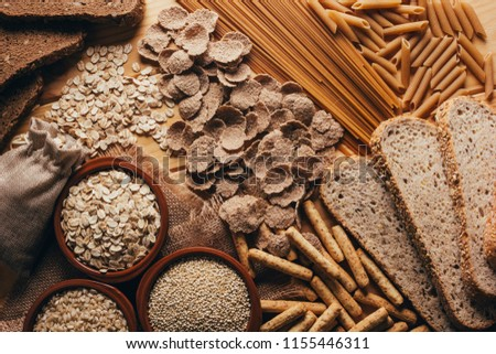Wooden table full of fiber-rich whole foods, perfect for a balanced diet #1155446311