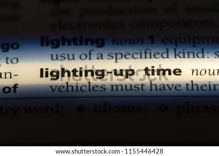 lighting up time word in a dictionary. lighting up time concept. #1155446428