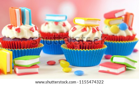 Bright colorful Back to School theme cupcakes with candy sugar art book topper decorations, children's party celebrations.