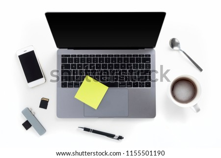 Top view of tabletop with laptop, mobile phone, memory cards, card reader, pen, coffee cup, spoon and post it notes isolated on white background #1155501190