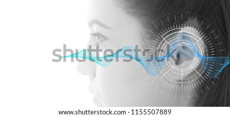 Hearing test showing ear of young woman with sound waves simulation technology #1155507889