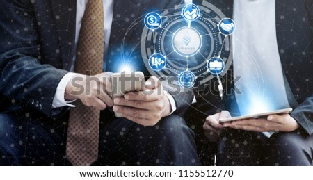 Ethereum and cryptocurrency investing concept - Businessman using mobile phone application to trade Ethereum ETH with another trader in modern graphic interface. Blockchain and financial technology. #1155512770