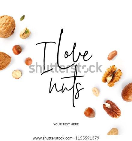 "Creative layout made of  quote ""I love nuts"". Food concept. Hazelnut nuts, almonds, walnut, peanut, pecan, cashew on white background. #1155591379"