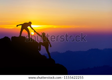 Teamwork friendship  hiking help each other trust assistance silhouette in mountains, sunrise. Teamwork of two men hiker helping each other on top of mountain climbing team beautiful sunrise landscape #1155622255
