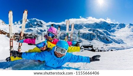 Happy family enjoying winter vacations in mountains, Val Thorens, 3 Valleys, France. Playing with snow and sun in high mountains. Winter holidays. #1155666406
