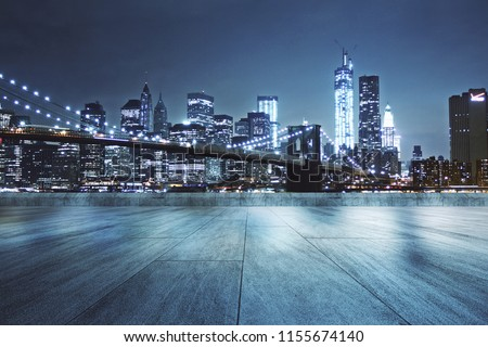 Concrete rooftop with beautiful night city view background  Royalty-Free Stock Photo #1155674140