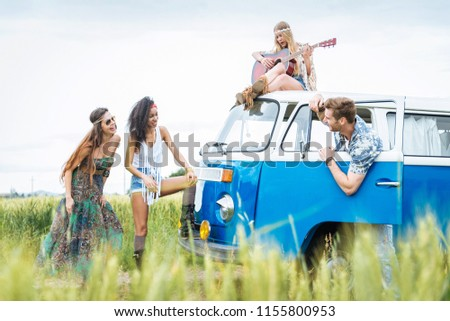 Group of friends travelling with a vintage minivan - Hippies driving into the nature #1155800953