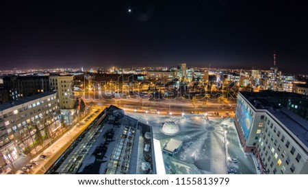 Kharkiv city from above at night winter timelapse. Aerial view of the city center and freedom square. Ukraine. #1155813979