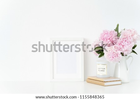 Stylish white a5 blank frame mockup. Still life composition, floral bouquet of pink peonies in jug. White background, mock up for quote, promotion, headline, design, and social media