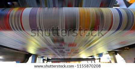 printing of coloured newspapers with an offset printing machine at a printing press  #1155870208
