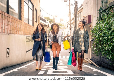 Three women doing shopping outdoors - Best friends meeting while shopping in Tokyo #1156002025