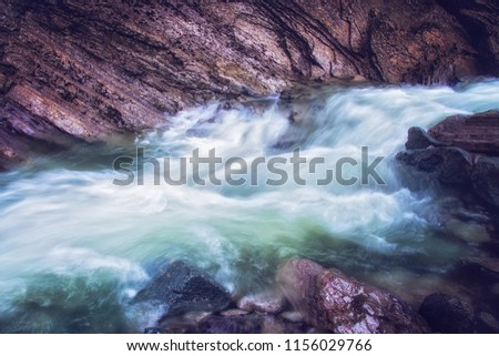 River flowing through rocky mountaing #1156029766