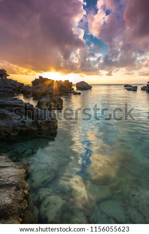 A beautiful sunset at Tobacco Bay in Bermuda. Tobacco Bay is located on the east coast of Bermuda in St. Georges. #1156055623
