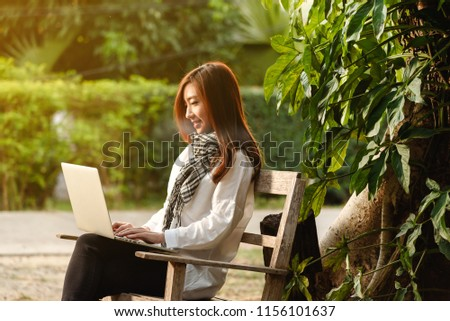 Beautiful young teenage woman freelance work with laptop on morning sun light, freelance lifestyle conceptual #1156101637