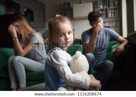 Frustrated little girl upset tired of parents fight looking at camera, portrait of sad preschool kid daughter suffers from family mom and dad arguments or lack of attention, child and divorce concept #1156208674