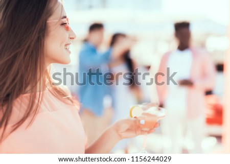 Side view optimistic young lady with attractive smile tasting appetizing beverage during rest #1156244029